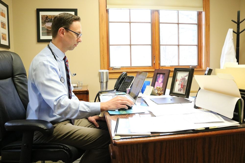 Doctor Knopp sitting at his desk