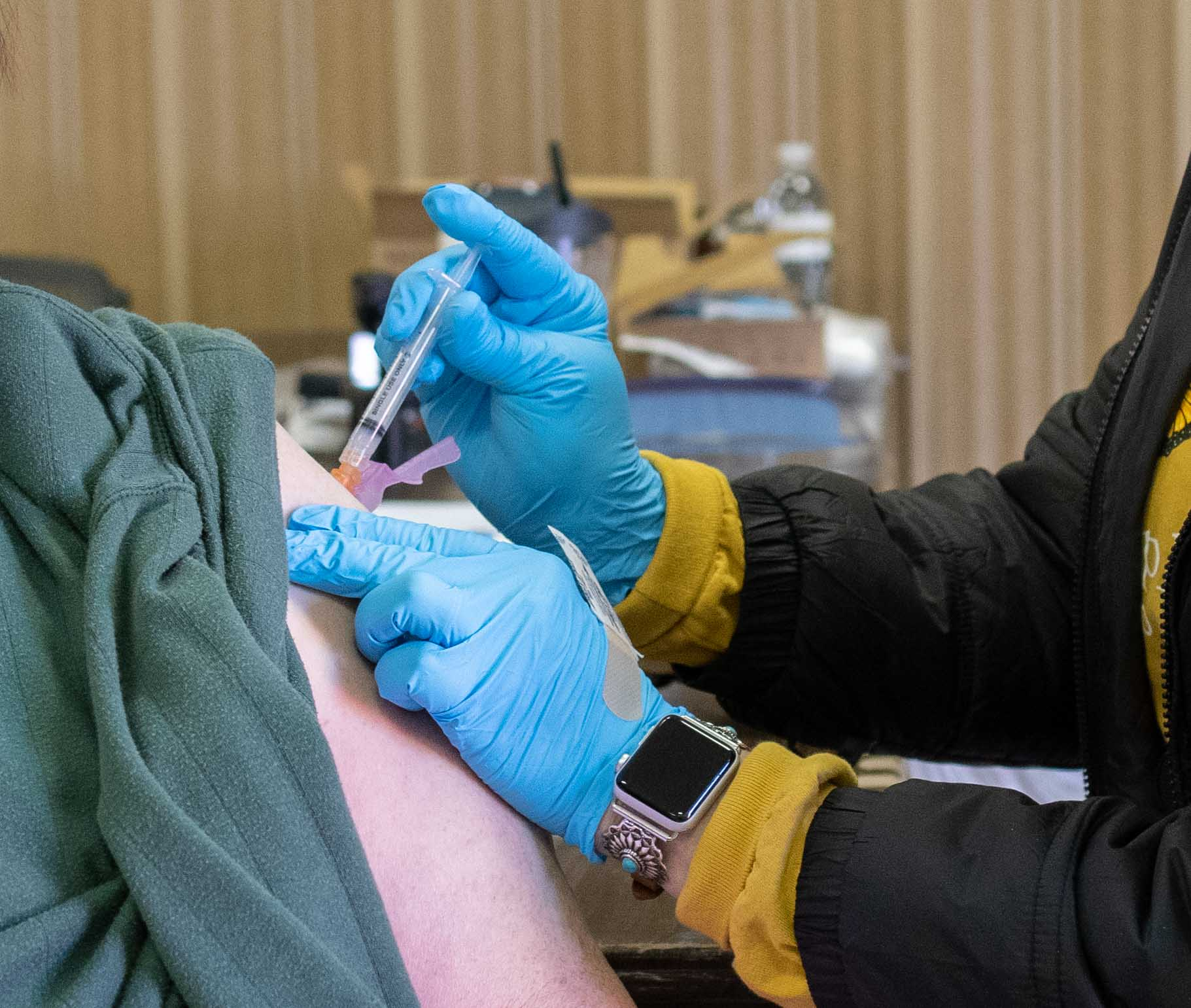 Woman being vaccinated in Riley County
